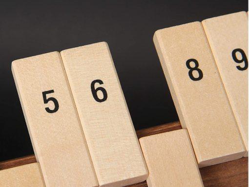 Klappenspiel aus Holz - Zahlen lernen